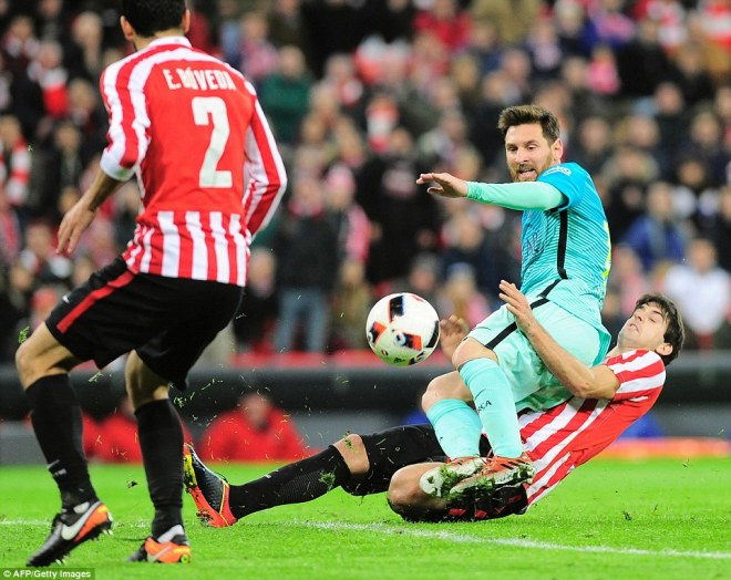 Athletic defender Mikel San Jose puts in a perfectly-timed challenge to deny Messi drawing Luis Enrique's side level