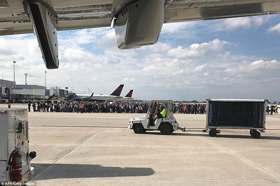 Photo courtesy of Taylor Elenburg shows passengers gathering on the tarmac of the Fort Lauderdale-Hollywood airport in Florida after a gunman opened fire