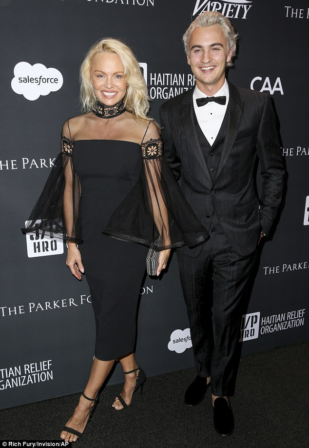 Looking sharp! Pamela Anderson stunned in a sheer black dress at the 6th Annual Sean Penn and Friends Haiti Rising Gala Benefit in Los Angeles on Saturday with son Brandon Thomas Lee