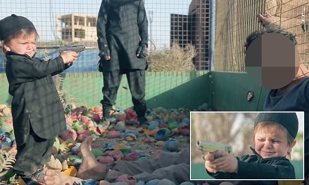 ISIS video shows toddler shooting prisoner dead in abandoned children's PLAYGROUND