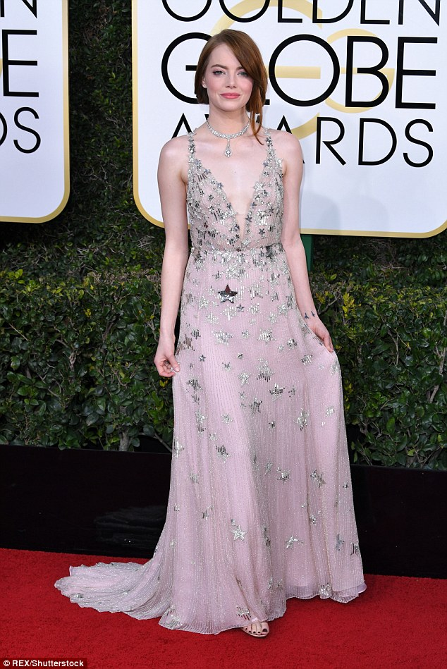 Out of this world! Emma Stone looked every inch the stellar movie goddess in a star-embellished gown at the 74th Golden Globe Awards on Sunday