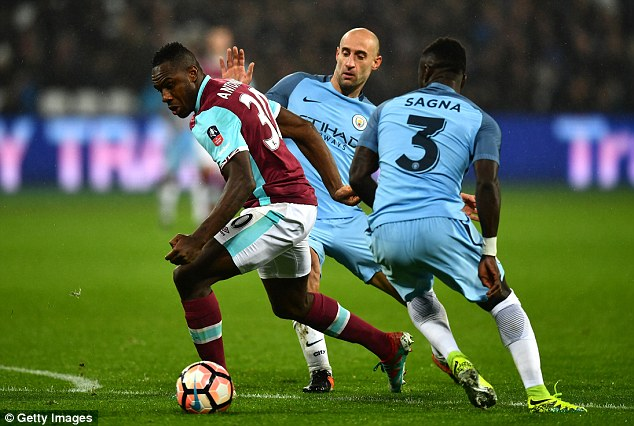 West Ham star Michail Antonio (left) is also being considered by the Premier League leaders