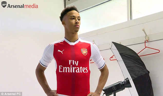 Bramall poses in an Arsenal shirt after signing a £3,000 per week deal with the Gunners
