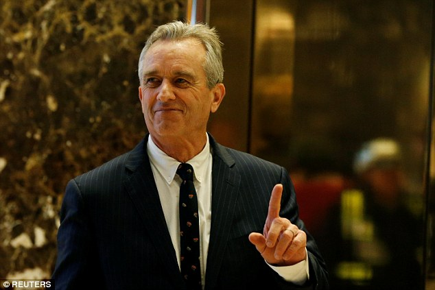 THIS MIGHT STING A LITTLE: Robert F. Kennedy Jr. gestures while entering the lobby of Trump Tower in Manhattan. He says Trump asked him to chair a commission on vaccine safety