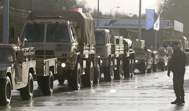 US Army vehicles are seen above as they cross the Polish border in Olszyna, Poland from Germany