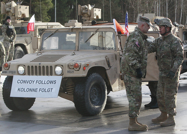 The first deployment of US troops crossed into western Poland on Thursday