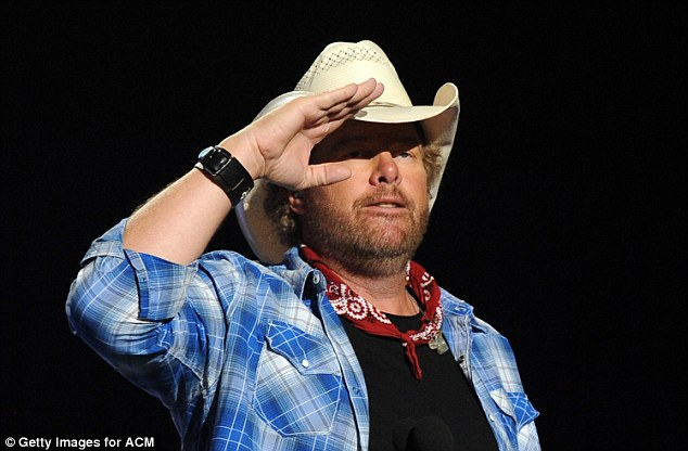 'I dont apologize:'Toby Keith, 55, responded to critics of his decision to perform for Donald Trump's presidential inauguration on Friday. He is pictured in April 2014