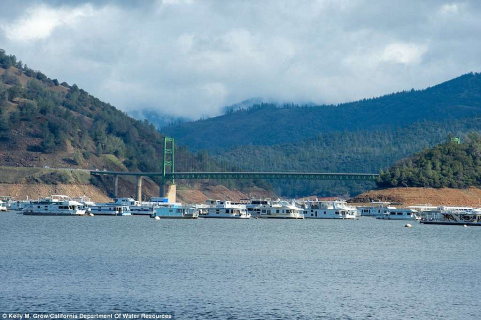 After a storm in January 2017, Lake Oroville's water levels are significantly much higher (above)