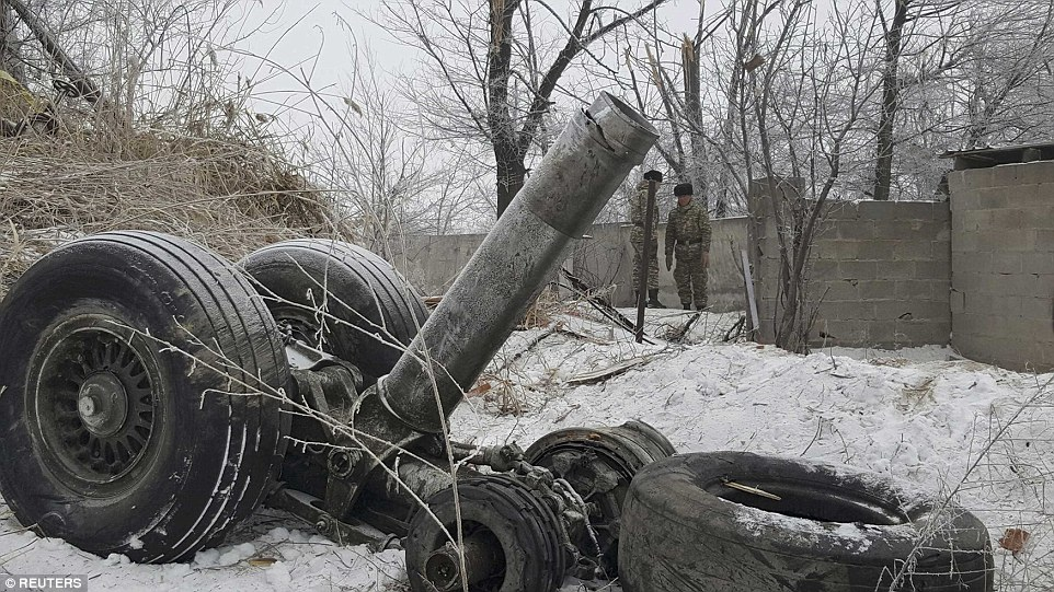 Wreckage, including landing gear and wheels (pictured), was found over a one hectare crash site, according to officials