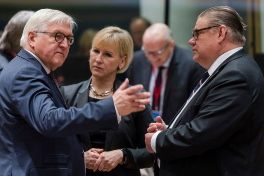 Germany's Foreign Minister Frank-Walter Steinmeier, left, talks with Finland's Foreign Minister Timo Soini, right, and Sweden's Foreign Minister Margot Walls...