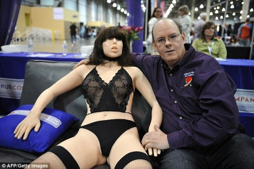 Douglas Hines, Engineer-inventor poses with his company's 'True Companion' sex robot, Roxxxy, which is one of the options that is already on the market