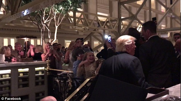 Video shot by Setticasi inside the Trump hotel in DC showed the president-elect climbed a flight of stairs while heading to his table, as a crowd of people cheered him on