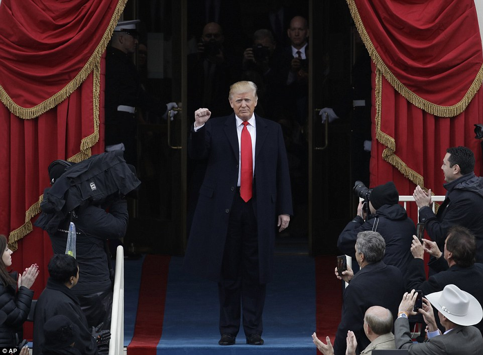 President-elect Donald Trump pumps his fist as he arrives for his Presidential Inauguration at the U.S. Capitol in Washington, Friday, Jan. 20, 2017