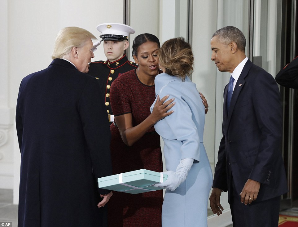Mrs Trump brought a large gift from Tiffany's which she then handed over to Mrs Obama. It's unclear what was in the box