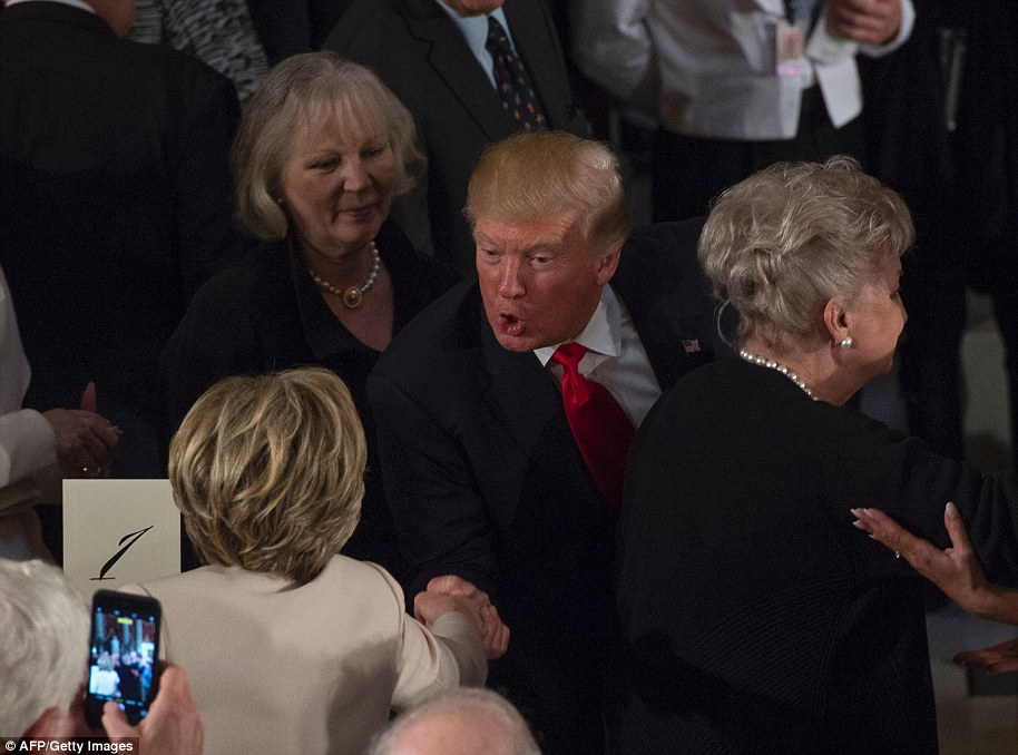 US President Donald Trump greets Hillary Clinton in Statuary Hall in the US Capitol for the Inaugural Luncheon following Donald Trump's inauguration as the 45th President of the United States, in Washington, DC, on January 20, 2017
