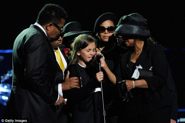 Paris was just 11 when Jackson died from cardiac arrest in 2009 caused by a lethal combination of prescription drugs. She is pictured here at his funeral in Los Angeles