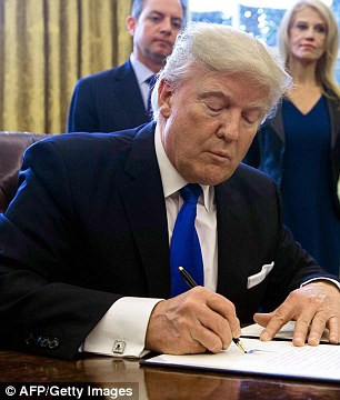 US President Donald Trump (above) is expected to sign several executive orders this week to jumpstart construction of a border fence and to restrict immigration from Syria and six other countries