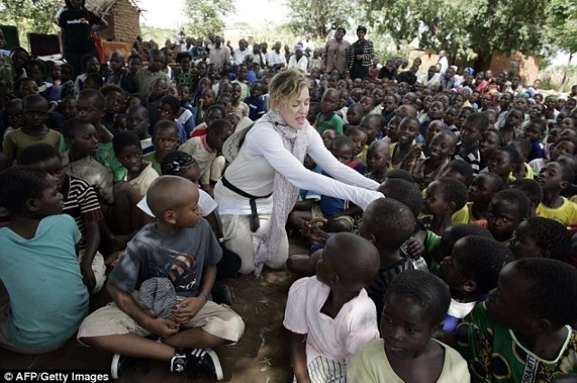 Pop star Madonna has filed for the adoption of two more children from Malawi, it has emerged. She is pictured in Malawi in 2013