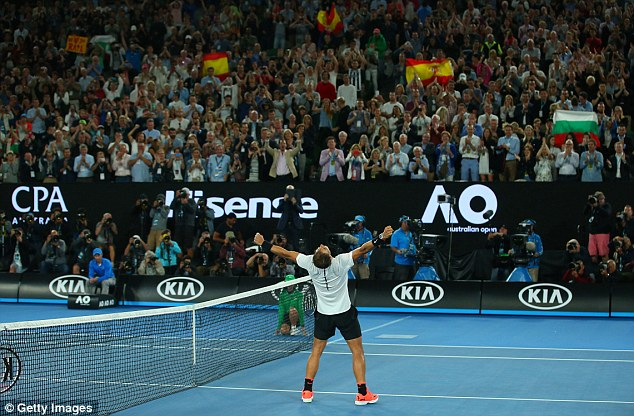Nadal celebrates in front of the Melbourne crowd as fans hold up Spain flags
