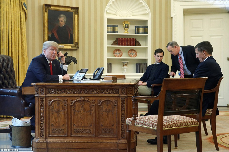 Trump is pictured with Jared Kushner, Communications Director Sean Spicer and National Security Advisor Michael Flynn during a call to the Saudi King on Sunday