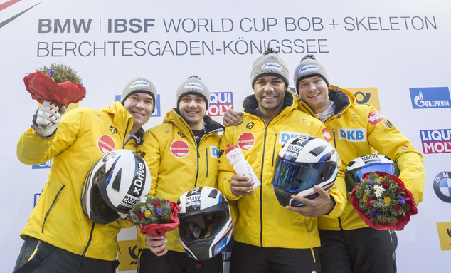 The German winning bobsled team with Johannes Lochner, right, Matthias Kagerhuber, 2nd left, Joshua Bluhm, 2nd right, and Christian Rasp, left, celebrate aft...