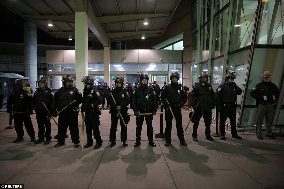 Port Authority Police Department blocked an entrance as protesters gathered outside Terminal 4 at JFK airport