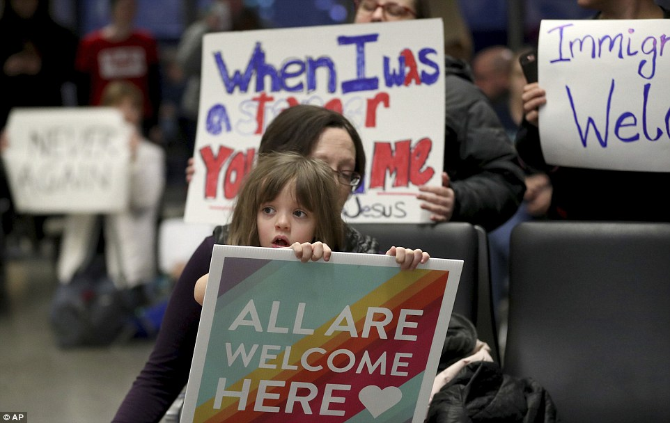 Demonstrators rallied atthe Minneapolis-St Paul International Airport Saturday afternoon to protest against Trump's ban