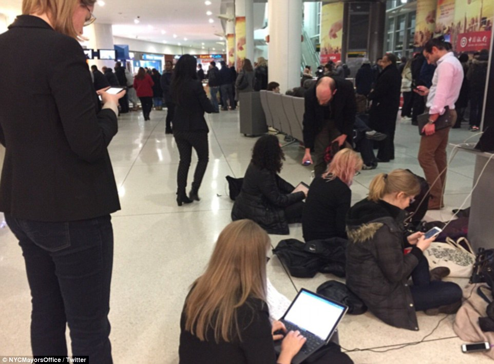 Volunteer lawyers are pictured working pro-bono Saturday in New York preparing petitions for detainees at JFK