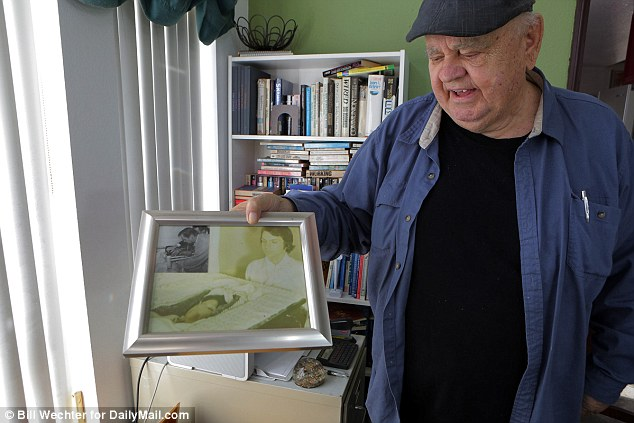 A 1979 court case, however, saw Nelson sued for $400,000 by some of the families of those he treated after he ran out of money to service his California cryogenic vault and left their bodies to decompose. Pictured, Nelson with photos of Mildred Harris  at her memorial service two years after she died; her son later sued Nelson