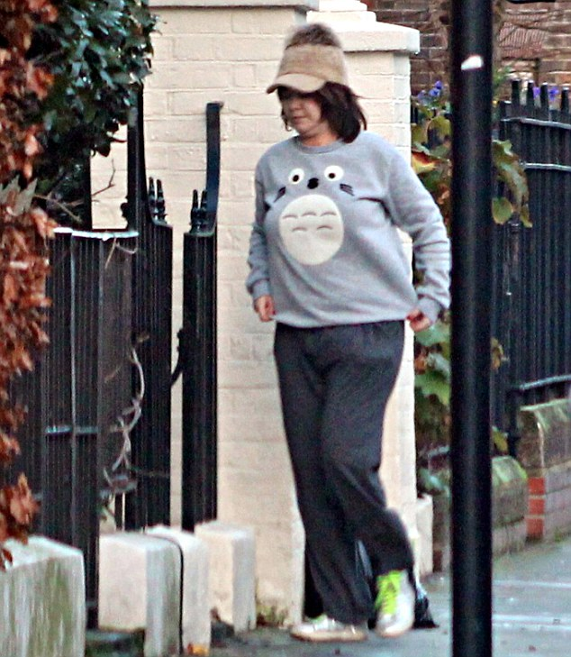She was photographed outside the property early on Friday morning, dressed in tracksuit bottoms and putting out the bins