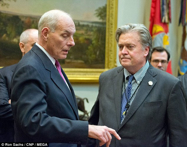 Kelly said discussions for the wall are of 'physical barriers but also of technological sensors.' He hopes to complete the wall in two years. Pictured: Kelly with Steve Bannon