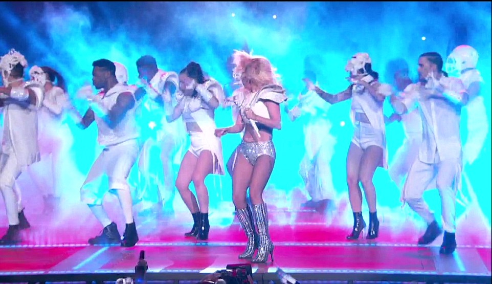 Quite a crowd: She then ratcheted the energy right back up again with a costume change and a team of dancers