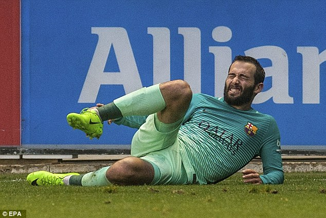 Aleix Vidal grimaces after going down during Barcelona's 6-0 victory over Alaves