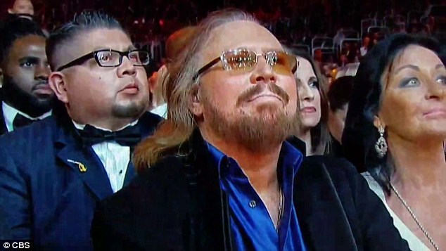 Proud: The Bee Gees' sole surviving member Barry Gibb lead a standing ovation after the all-star tribute he received at Sunday's Grammy Awards