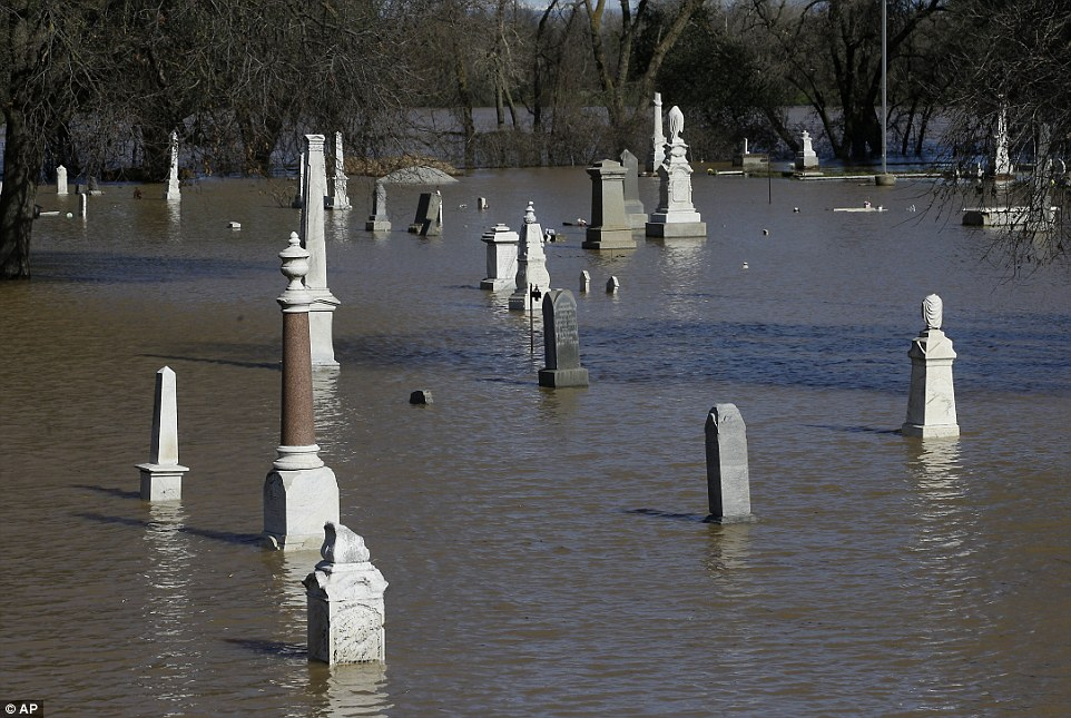 Water from the nearby Feather River floods the Marysville Cemetery on Saturday in Marysville, California
