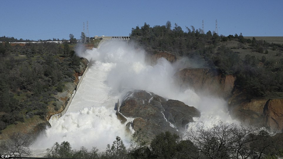 The auxiliary spillway at the Oroville Dam was expected to fail by 5:45pm local time on Sunday, which could have sent an 'uncontrolled release of flood waters from Lake Oroville'. Water continues to gush down the dam's main spillway on Saturday