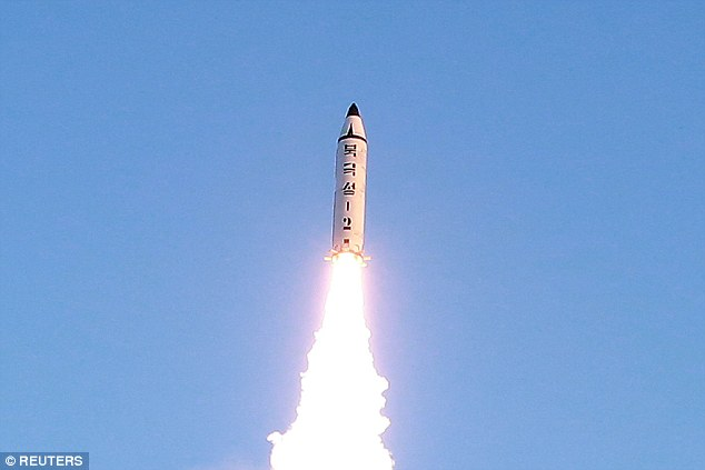 Pictured is the test-fire of the new Pukguksong-2 missile, guided by North Korean leader Kim Jong Un on the spot