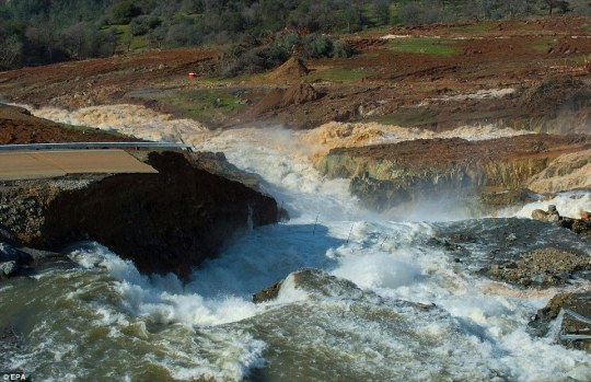 When water began flowing through the emergency spillway, it buckled under the pressure and nearly gave way entirely. Above the scene on Sunday as water flowed through the emergency spillway