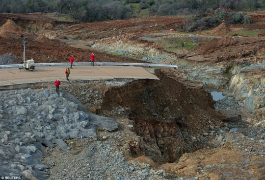 Workers are trying to repair the emergency spillway so that it may be used again if the main spillway erosion worsens which they now say they have achieved