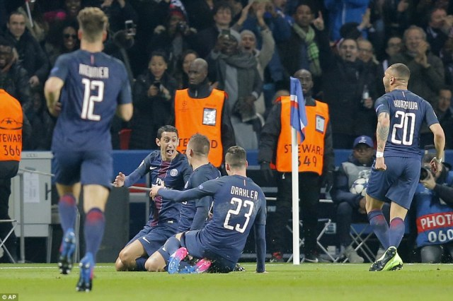 The Paris Saint-Germain players dash over to the corner to celebrate with Di Maria after his goal stunned Barcelona