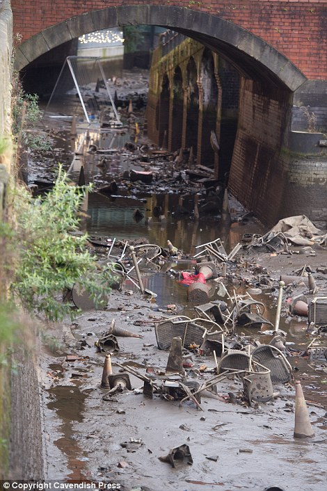 Manchester canal drained to reveal piles of rubbish