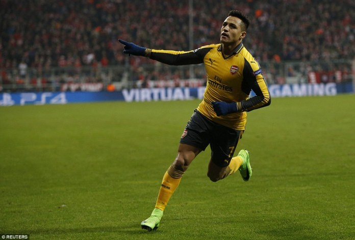 Sanchez celebrates scoring for Arsenal earlier on - but his penalty would not give the Gunners a base for victory
