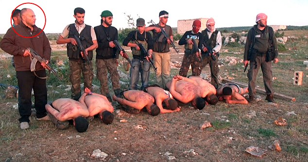 Sakhanh's arrest came after footage emerged of him taking part in in the 2012 mass execution of seven government troops in Syria (he's pictured above left)