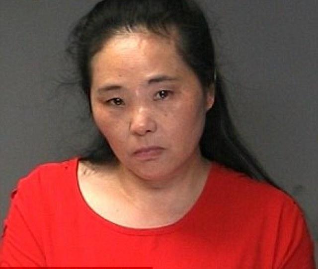 Jianping Qiao And Jinjuan Gu  Pictured In Her Tearful Mugshot Were