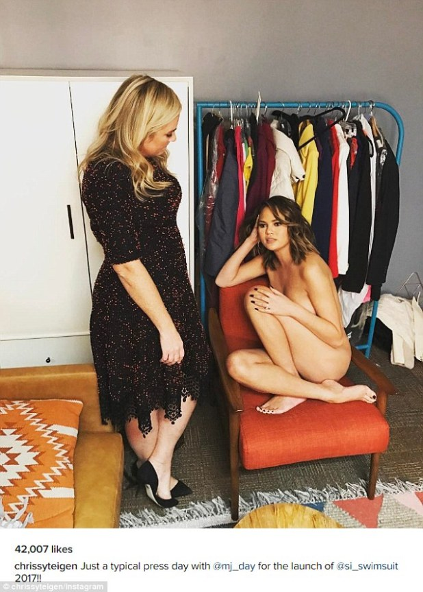 Just another day in the office: Chrissy Teigen ditched her clothes and chatted to the editor of Sports Illustrated on Thursday while completely naked