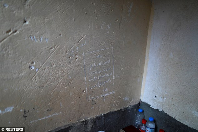 The wall in his cell is clearly marked with markings that have been scratched into the surface