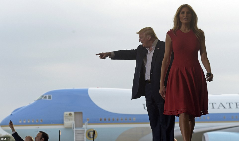 President Donald Trump and first lady Melania Trump arrive for a campaign-style rally at Orlando-Melbourne International Airport