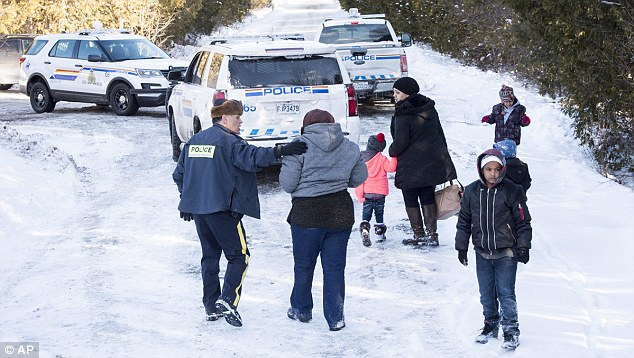 Image result for images of asylum seekers arrested at Canadian border