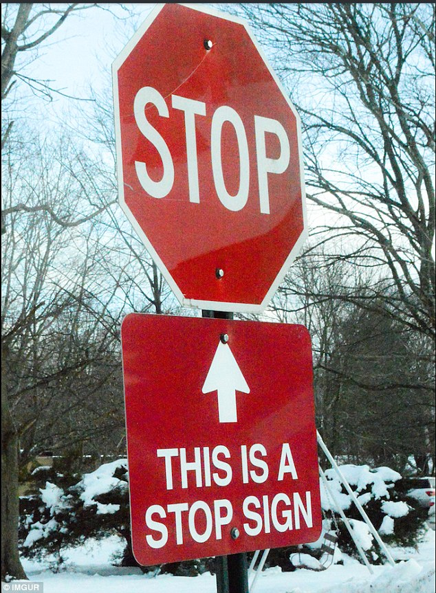 A stop sign with a sign under it to remind you that the above stop sign is a stop sign - information overload?