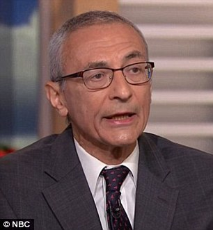 Podesta (left in December) said the FBI director James Comey was 'inexplicable' in his treatment of the investigation into Clinton's emails versus its approach to the DNC hack